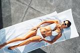 Pretty woman sunbathing outside