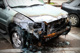 Close up of a damaged car, after fire.