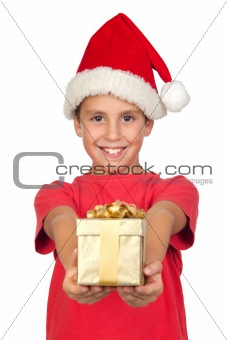 Adorable child with Santa Hat offering a gift