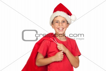 Adorable child with Santa Hat looking in sack