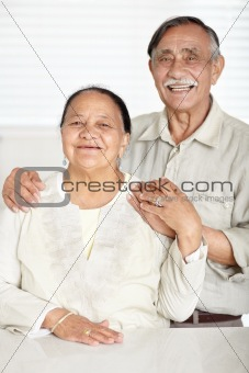 Smiling old couple standing together