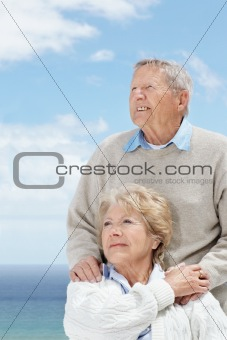 Cute mature couple looking away in thought