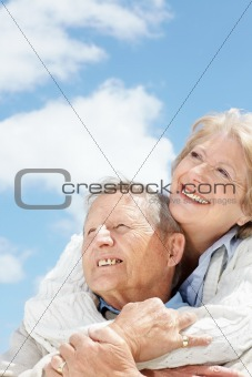Cute senior couple looking away in thought