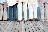Group of people standing on wooden plank - Outdoor