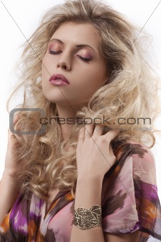 beautiful woman with long curly blond hair and makeup