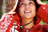 Pretty yoiung woman wearing raincoat looking up