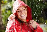 Portrait of smiling teenage girl enjoying the rain