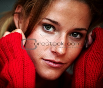 Confident young woman wearing a red sweater