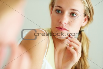Skin conscious - Lovely young gir touching her face