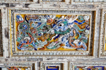 detail of the roof of a Emperor palace in Hue, Vietnam