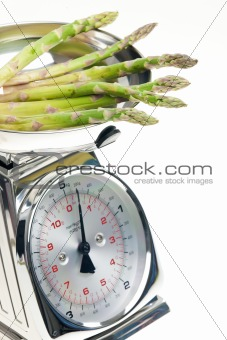 green asparagus on kitchen scales