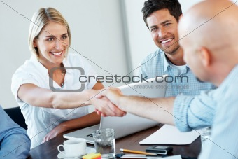 Successful businesspeople shaking hands making a necessary agree