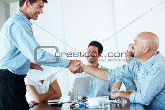 Businessman appreciating his business colleague in meeting