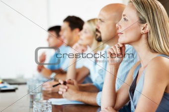 Successsful business people attending a seminar