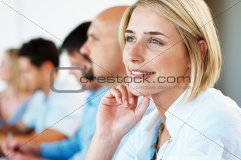 Thoughtful young business woman looking away in meeting