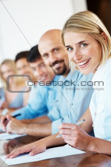 Group of businesspeople taking notes during a seminar