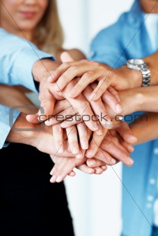 Unity - Business people hands on top of each other