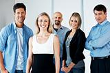 Business team - Young attractive businesspeople standing
