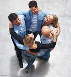 Top view of a team of business colleagues standing in a huddle
