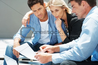 Successful couple going over figures with their accountant