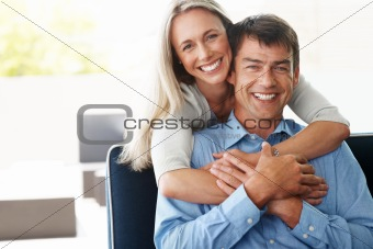 Portrait of an attractive happy couple enjoying at home