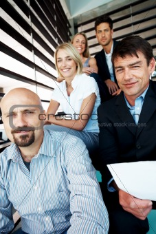 Business people sitting together on steps - Break