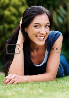 Cute young woman relaxing in park