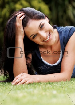 Gorgeous young lady relaxing in the park