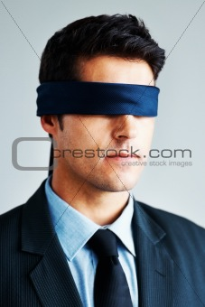 Blindfolded executive