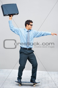 Confident businessman on skateboard