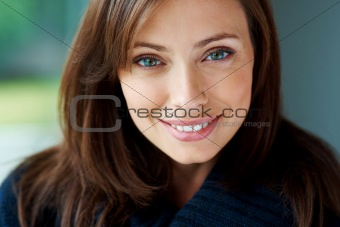 Closeup of a pretty young lady smiling  