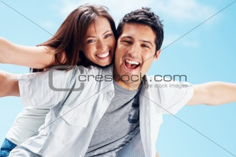 Happy young couple enjoying their summer holiday