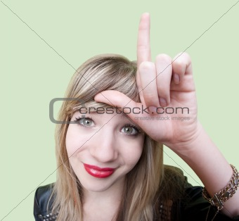 Lady Makes Loser Sign