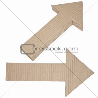 two arrows made of corrugated cardboard directed to the right