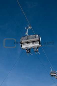 Chairlift against blue sky