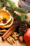 Different kinds of spices, nuts and dried oranges - christmas decoration