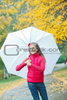 Cute girl with white umbrella walking