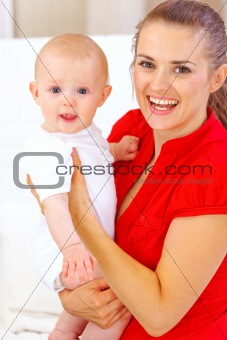 Portrait of happy baby and smiling mommy
