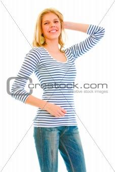 Smiling beautiful teen girl posing on white background