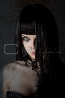 Young witch with yellow eyes