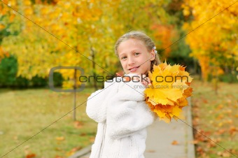 Girl with yellow leaves 