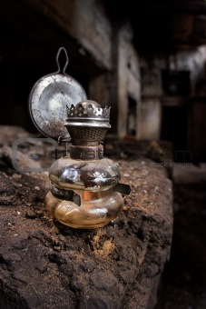 Old Kerosene Lamp in an abandoned, gloomy, creepy building of an