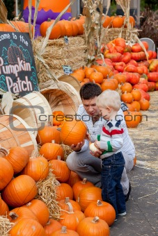 family at the pumpkin patch