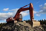 Excavator in quarry