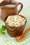 Oat flakes and milk - concept of a healthy breakfast