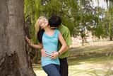 Happy kissing neck nest to garden tree