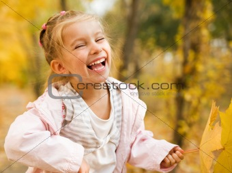 Little girl outdoors in autumn
