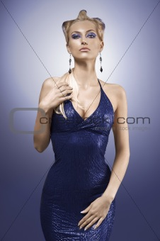fashion shot of a pretty blonde girl in a blue dress