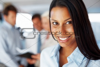 Closeup of successful young businesswoman smiling