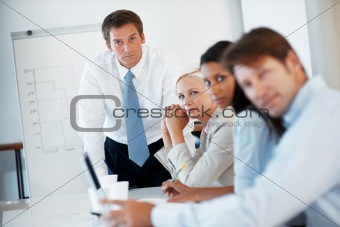 Businesspeople sitting together during a presentation